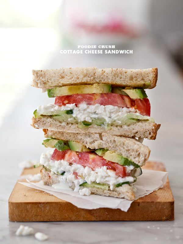cottage cheese sandwich ...  toast bread.  butter bread.  top slice of bread with cucumber, cottage cheese, tomato and avocado. season with salt and pepper.  top with final slice of bread.  eat. wipe chin.  mmmmmmm :)