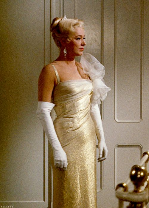 The Baroness ~ The Sound of Music.  I've always thought this dress was beautiful.