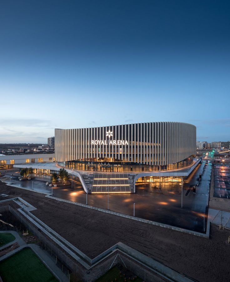 Danish firm 3XN has completed a large sporting and cultural arena in Copenhagen, featuring a glazed curtain wall wrapped in timber fins.