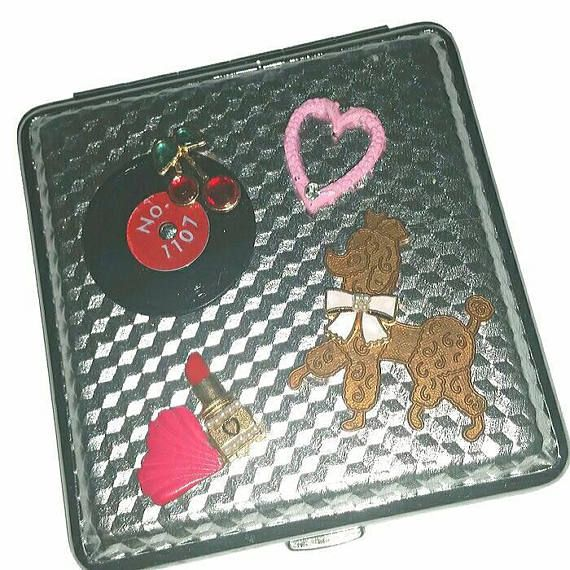 Check out this item in my Etsy shop https://www.etsy.com/ca/listing/592330835/rockabilly-love-cigarette-case-holder