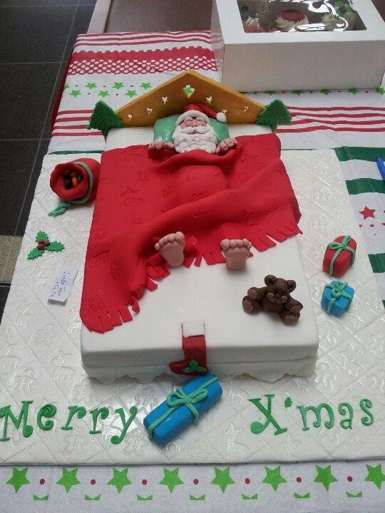 Christmas Santa in a bed