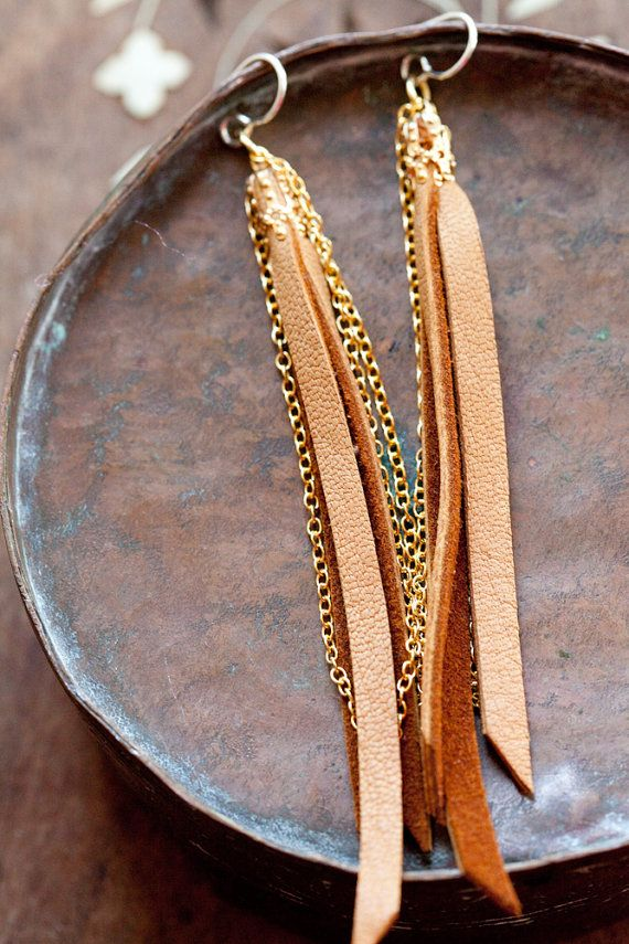 http://www.etsy.com/listing/92566981/leather-earrings-golden-tan-leather   strips of soft leather and chain capped with gold colored finding  sterling silver earwires