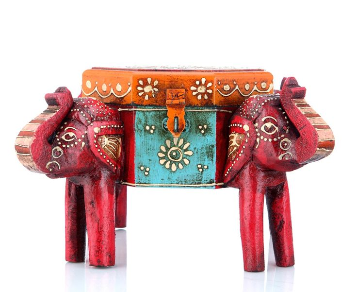 A multipurpose box carved and supported with four elephant heads . The vibrant colour add to it's beauty (There may be very MINOR VARIATIONS in color combinations and figure designs, between displayed and dispatched products, due to variety of artisans who handcraft the products. The look, feel and quality will , however, be consistent with what you see. That is an Indikala promise).