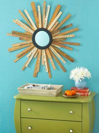 Repurposed rulers turned into starburst mirror. Goodness! I see these old rulers everywhere! Future DIY. More info here: http://www.bhg.com/decorating/do-it-yourself/accents/repurposed-ruler-starburst-mirror/