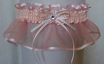 Fashion and style without limits. Lt CORAL Moonstone Sheer Elegance Organza Garter with silver accent bow and crystal rhinestone eye by Custom Accessories Garters LLC. Wedding Garter – Bridal Garter – Prom Garter – Fashion Garter. Visit: www.garters.com/page42d.htm
