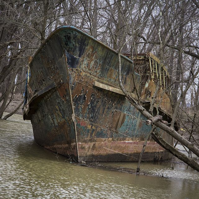 """""""Ghost Ship"""" in a creek near Cincinnati off Ohio river. The """"Circle Line V"""" was launched on April 12, 1902 as the """"Celt"""" and has had a long and interesting history before being ground in the creek off the final owner's property in 1986. It rots there to this day. More info at: http://queencitydiscovery.blogspot.com/2013/03/the-ghost-ship.html"""