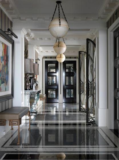 Jean Louis Deniot stunning black white grey entryway / foyer.  Flooring, walls, woodwork trim detail, doors, lighting. Wow. Modern Glam. One of the best!