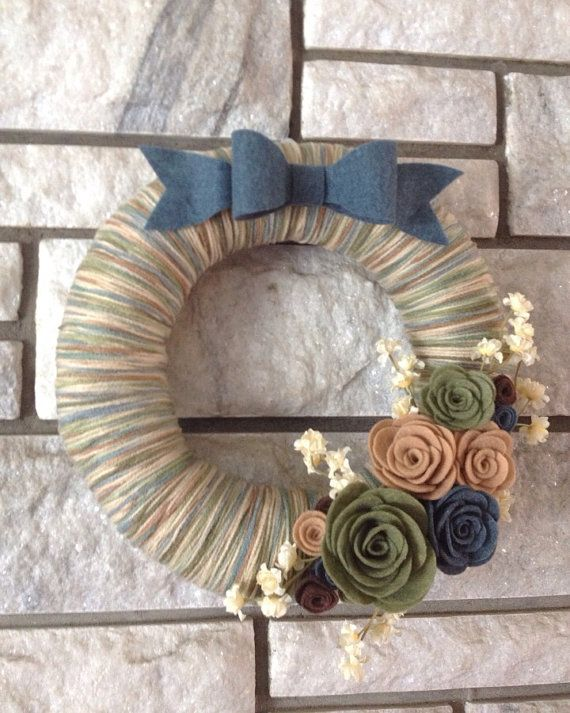 Hey, I found this really awesome Etsy listing at https://www.etsy.com/listing/156915267/yarn-wreath-handmade-felt-decoration-bow