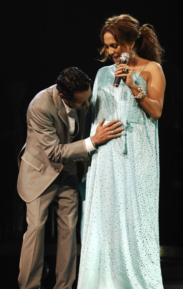 """After weeks of speculation, former couple Marc Anthony and Jennifer Lopez chose to announce her pregnancy on the last show of their joint U.S. tour in 2007 in Miami. After thanking her fans for all of their support, Lopez went on to say to an ecstatic crowd, """"Marc and I are expecting."""" - Photo: Getty Images"""
