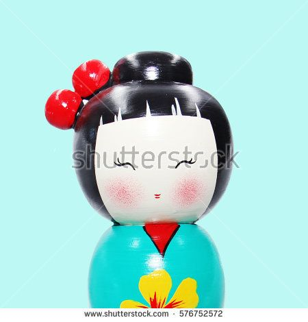 Asian doll wooden statue