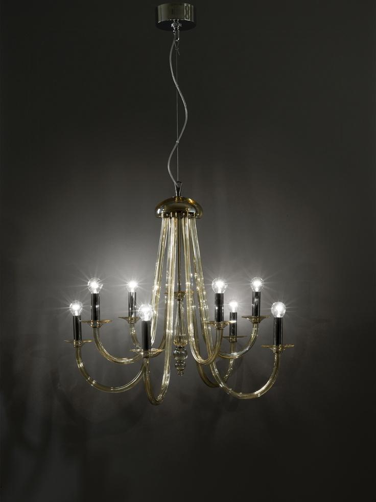 375/6 Sospensione 6 luci color Ambra  lampada a sospensione (lampadario) a 6 luci (6 bracci) disponibile in cristallo trasparente e montatura cromo oppure in cristallo color ambra e montatura oro.