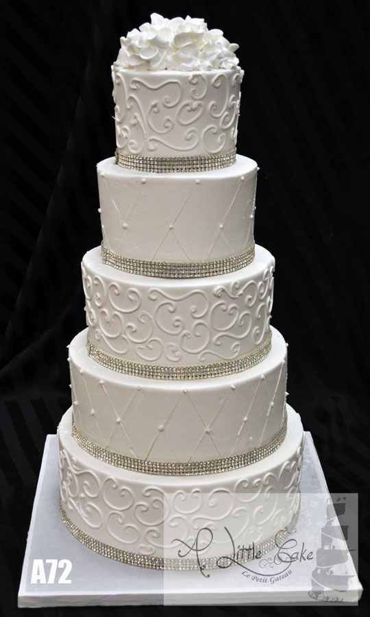 Buttercream iced wedding cake with rhinestone bands