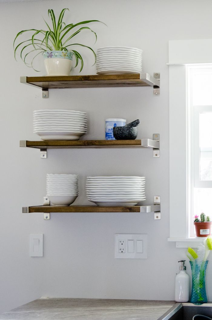 Open shelves are very practical in the kitchen and if you don't have any perhaps you should make some. You can use some of these Ikea brackets that have a finish which will most likely match your appliances. Attach them to wooden boards and make those shelves you wanted.{found on lemonthistle}.