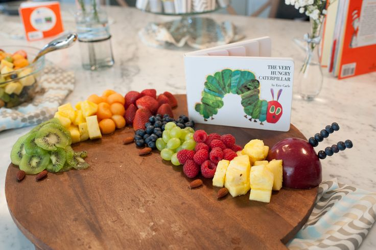 "Construct your own ""Very Hungry Caterpillar"" using half an apple for a head, blueberries on toothpicks for the antennae, almonds for feet, and multi-colored fruit for the body. 