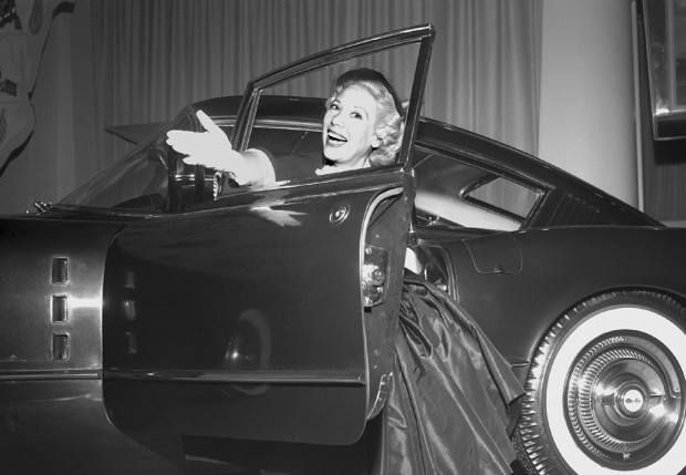 It's #TriviaTuesday! Anyone know who this beauty is with a wonderful 1954 Chevrolet Corvette Corvair? (Winner gets $50 to Amazon!)