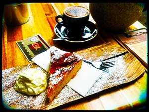 At Alcove Cafe and Deli Love the gorgeous presentation of my humble (but tasty) flourless orange and almond cake.
