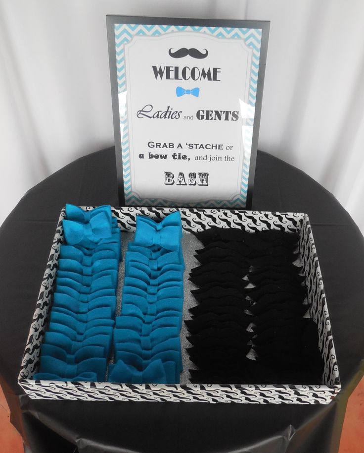 Mustache Party welcome bow ties and mustaches pins.