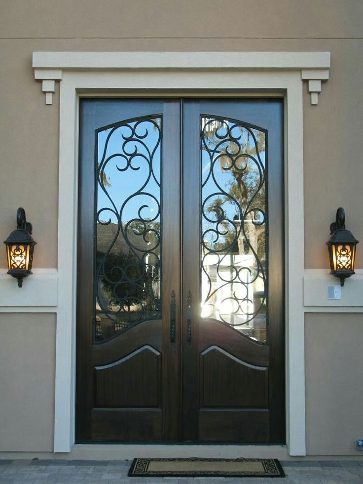Decoration Inspiring Black Double Entry Doors With Wrought Iron Glass  Inserts And White Crown Molding Also Oil Rubbed Bronze Lever Handles  Alongside Antique ...
