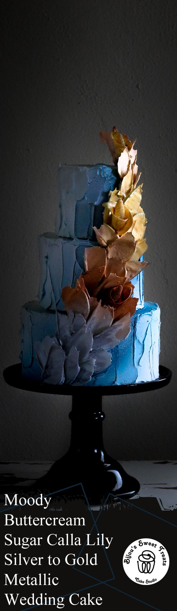 Our moody style all buttercream wedding cake with sugar calla lily mixed within a silver to gold fading metallic cascading buttercream swags. #weddings #weddingcake #buttercream