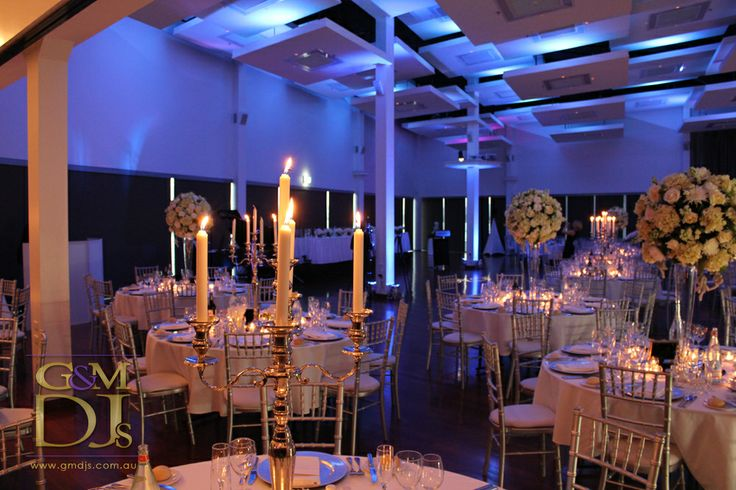 Wedding DJ Brisbane at Moda Events Portside. Blue wedding reception lighting | G&M DJs | Magnifique Weddings #gmdjs #magnifiqueweddings #weddinglighting #weddingdjbrisbane #modawedding #modaevents @gmdjs @modaeventsvenue
