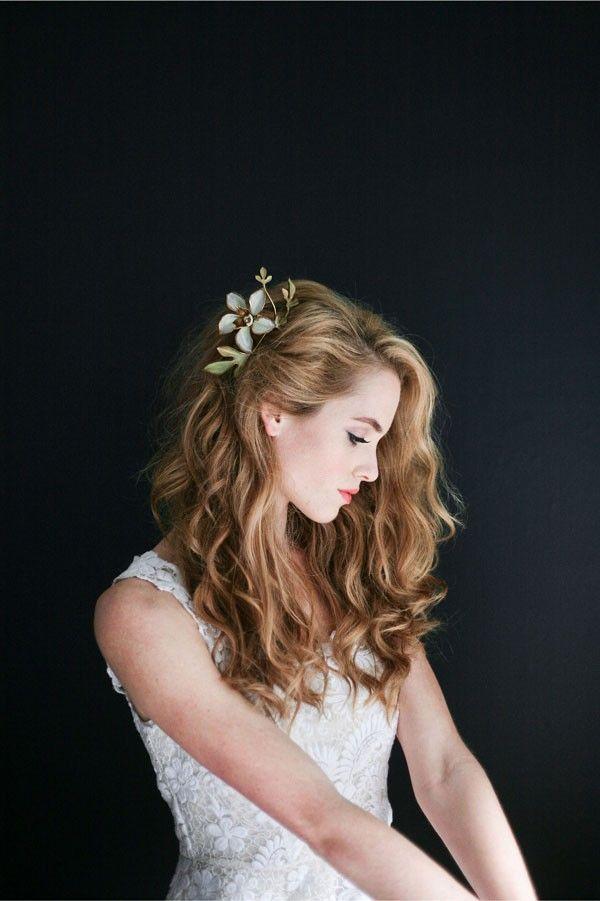 Pretty floral clip with long, loose waves. @myweddingdotcom