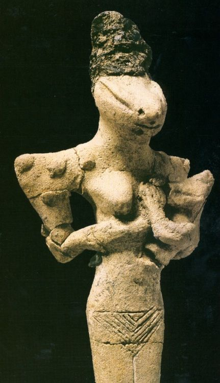 Snake Goddess and Child (Woman Suckling a Child), Ubaid 4 Period (first half of the fourth millenium BCE), terracotta.  Baghdad, Iraq Museum...