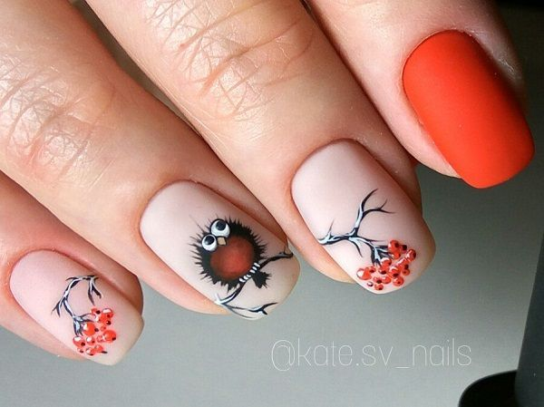 Owl Love. The Nude and Bold combination of Orange and Off color is just an inspiration this season. The amazingly drawn owl with the tree branch looks perfectly perfect with the matte orange on index finger nail.