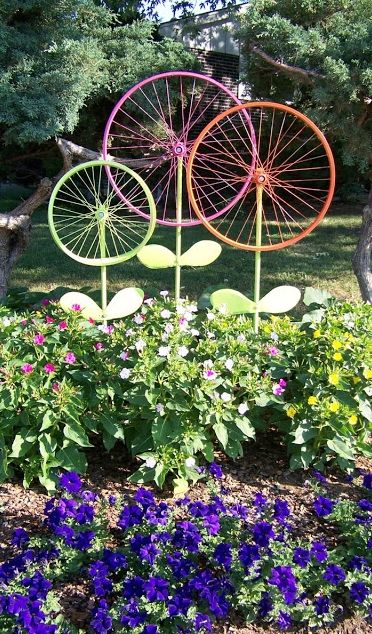 Before taking that old bike to the junkyard, consider this garden ornament idea from The Hanky Dress Lady: Bicycle Wheel Garden Art - Steel Magnolias.