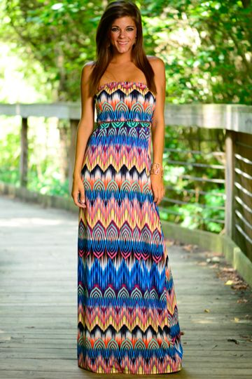 This vibrant maxi is absolutely amazing! This is perfect for that fun summer day! The material is super cool and the print is to die for! With colors galore, you are sure to have a fun time in this town gown!