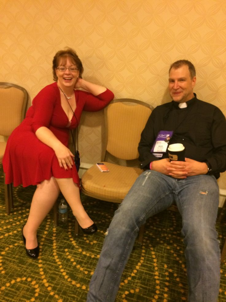 After the Saints and Sinners Ball - a priest and a lady in a red dress were hanging out together looking very happy...