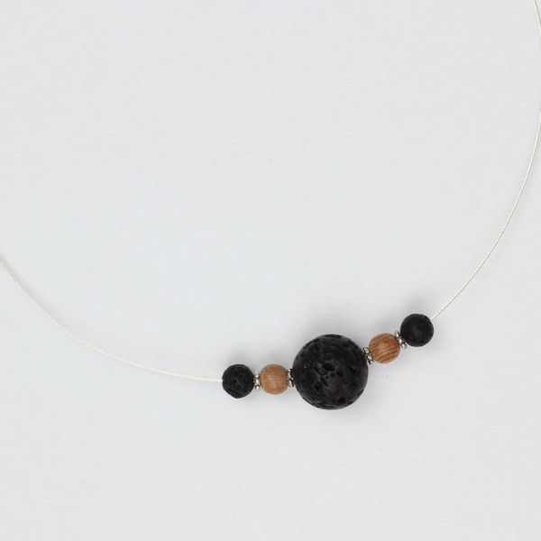 Heroine Necklace | Made with three lava beads to diffuse essential oils, rosewood, Tibetan silver and sterling silver findings | Would look really nice with a flowing black dress!