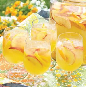 Peach Sangria from Seasons is the perfect accompaniment to a late summer barbecue! It's gingery and sweet.
