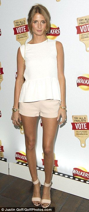 Style queen: The former Celebrity MasterChef contestant wore a white loose fitted peplum top with nude shorts and heeled sandals
