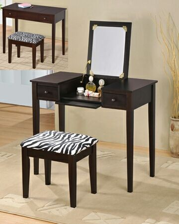 """2 pc espresso finish wood bedroom make up vanity dressing table with flip up mirror and stool with zebra print material. This set includes the vanity table with flip up mirror and fold down front panel with 2 side drawers and a zebra print fabric covered stool. Measures 36"""" x 18"""" x 30"""" H (47"""" with mirror flipped up). Stool measures 18"""" x 12"""" x 18"""" H. Some assembly required. SKU AD546-ESP"""