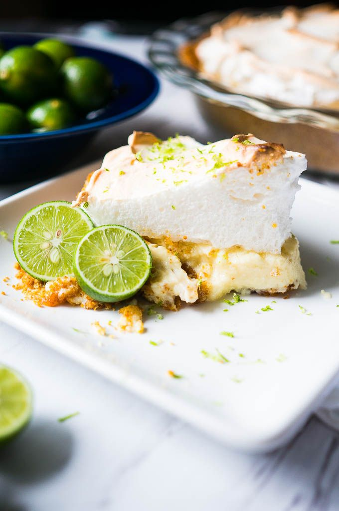 Key Lime Pie with Fluffy Meringue. A tart and creamy key lime filling with a fluffy sweet meringue on top!