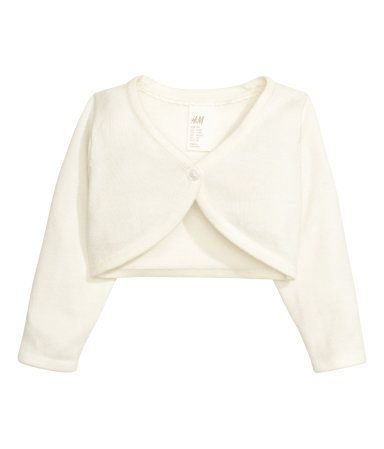 Fine-knit bolero in soft cotton with long sleeves and a heart-shaped button.
