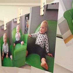Use monthly pictures taken of your babies 1st year as decorations for baby's 1st birthday party.