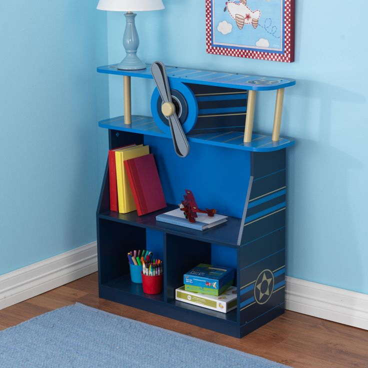 It's time to takeoff and fly away with our adorable Airplane Bookcase. The young aviators in your life are sure to love this fun, convenient furniture piece. Fe