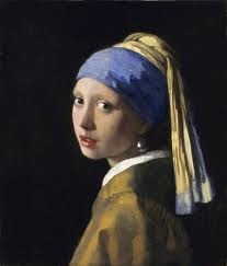 Vermeer - Girl with pearl earring.  Her gaze is forever timeless.