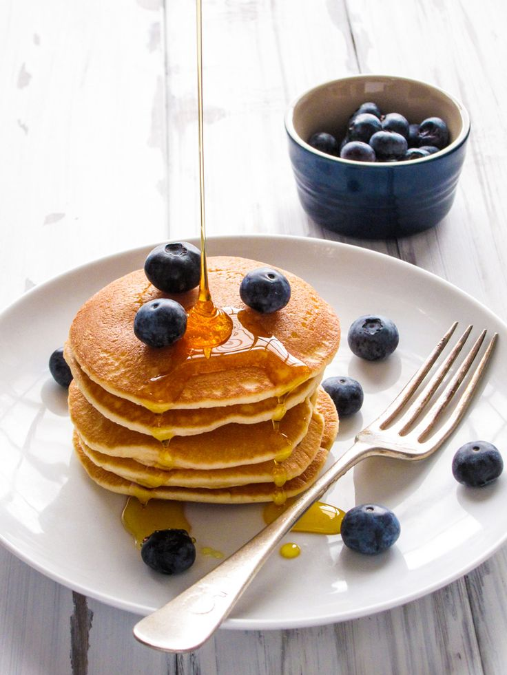 Stacked Pancakes with blueberries and runny honey at a food photography with Blogger Skills Academy