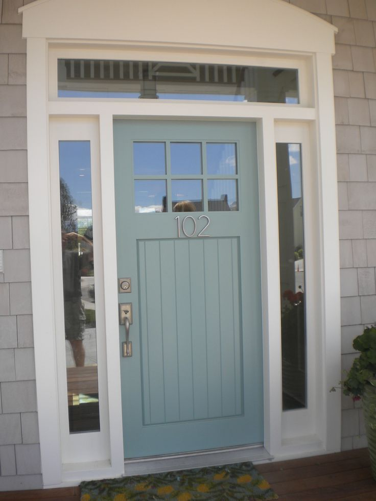 blue-gray front door with brushed nickel hardware