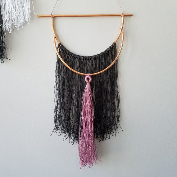 Modern bohemian wall hanging with 120 strands of fringe and 50 strand tassel. Copper accents are hand bent and attached with copper wire. The fringe and tassel are handmade using 100% strung linen and wrapped with the same linen and copper wire. This wall hanging is perfect for any boho chic decor, wedding, nursery, and more! Price includes one hanging!  OVERALL SIZE: Height: 20 Width: 12.5  MATERIAL CARE: WALL HANGINGS: I take special care in the packaging of all wall hangings but they may…