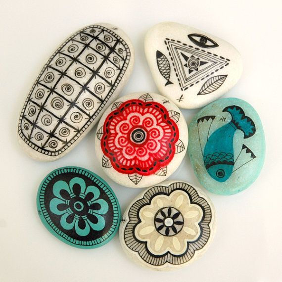 handpainted stones - sun mandalas and ancient symbols