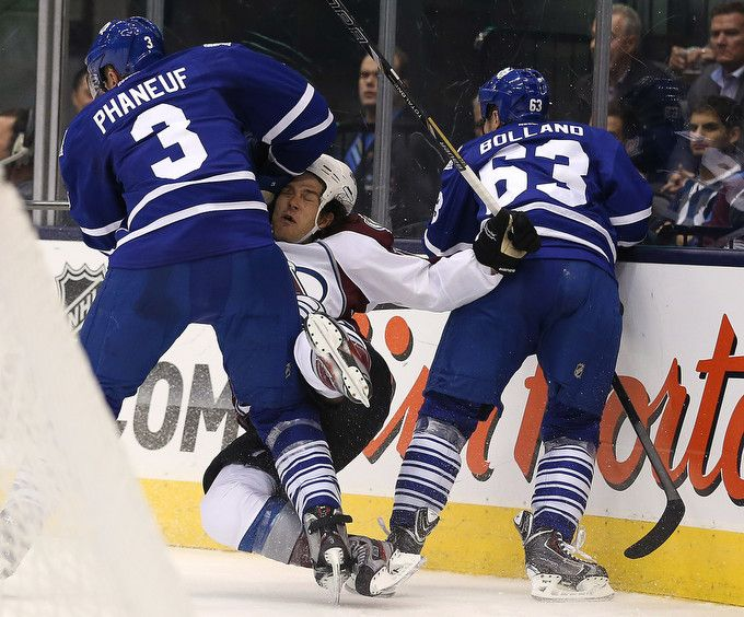 Some of our favourite Star #photos from October. Dion Phaneuf levels Steve Downie as the Toronto #MapleLeafs play the Colorado #Avalanche.