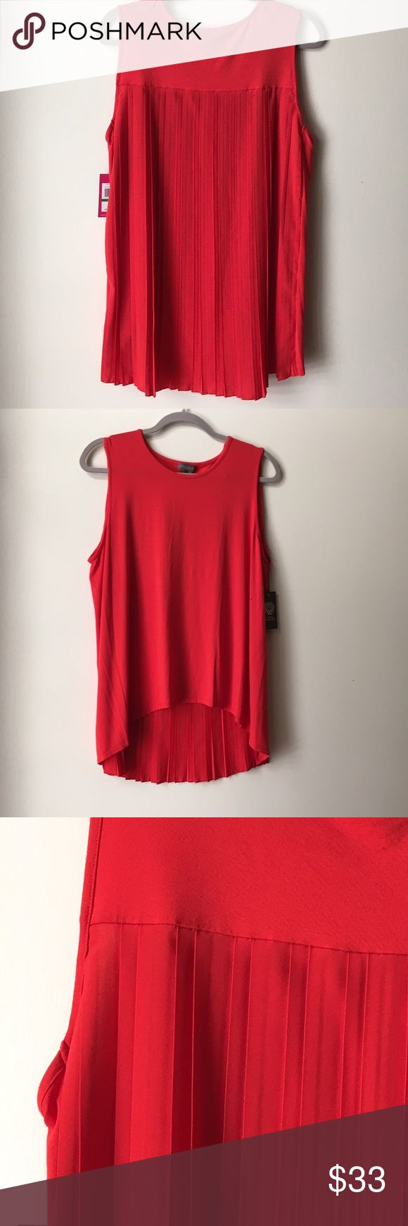 VINCE CAMUTO Pleat-Back Hi/Lo Tunic Tank (M) *NWT* A bright red tunic top is fashioned with a smooth stretch-knit fabric on front and silky pleats that drape from back yoke to high-low hemline. By Vince Camuto.  SIZE:  Medium COLOR:  Pepper (Red)    - Jersey & Crepe-like mixed fabrication   - Sleeveless   - Scoop neck   - Pleated-back panel   - High-Low hem   - Imported  CONTENT:  Body: 96% Rayon, 4% Spandex. Combo: 100% Polyester.    CARE:  Machine wash cold, tumble dry low.   *** NEW WITH…