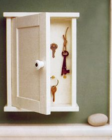 An old medicine cabinet or cigar box may solve the age-old problem of misplaced keys. Invite holiday visitors to hang their keys in this key corral (shown in unfinished pine and painted white) and avoid the hunt. When you have selected an appropriate box, screw in a few cup hooks, and add the handle of your choice.