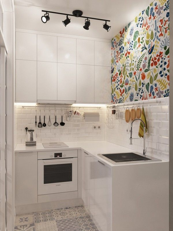 tiny kitchen design wall art or colorful wallpaper in this tiny white kitchen - Small Apartment Kitchen Design Ideas
