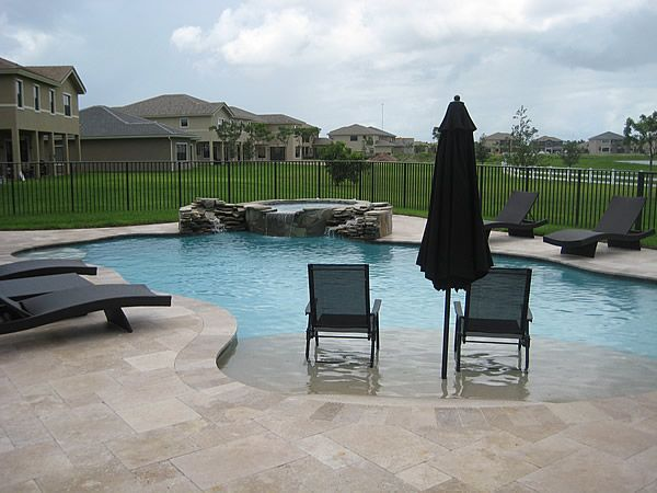 sunshelf pool | This pool remodel included a new sun shelf with umbrella, natural walk ...