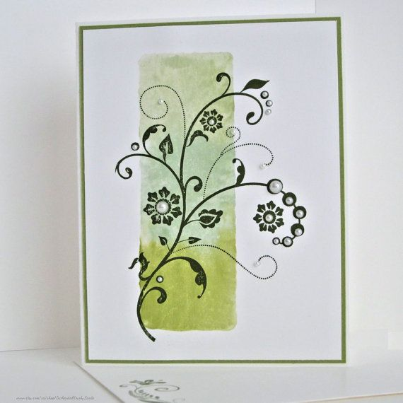 Blank card (no sentiment). Floral flourish stamped in grey ink and embellished with faux pearls. Hand stamped background in subtle greens