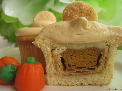 Mini pumpkin pies inside a cupcake... my favorite thing to bring to Thanksgiving dinner!